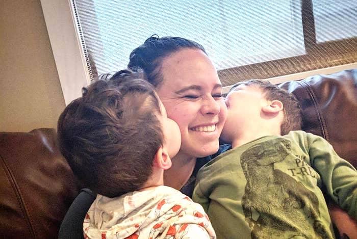 twin boys kissing mom balance career and kids