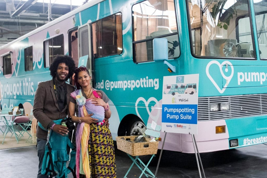 couple in front of pumpspotting booth new york baby show