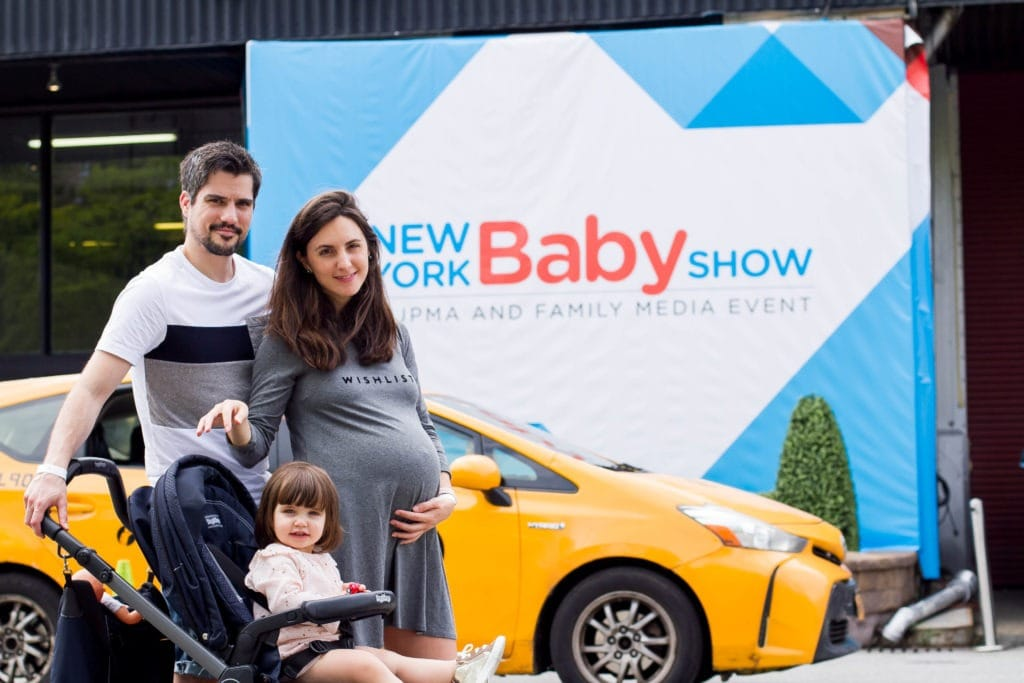 couple and baby at new york baby show