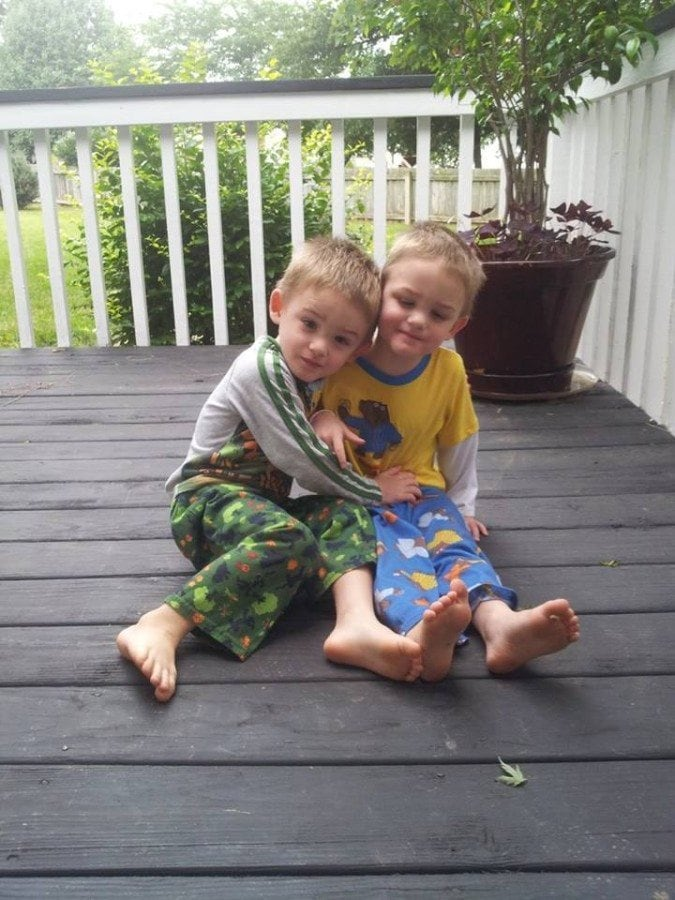 twin boys sitting on porch autism