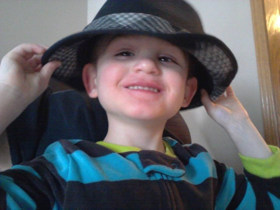 boy wearing hat autism