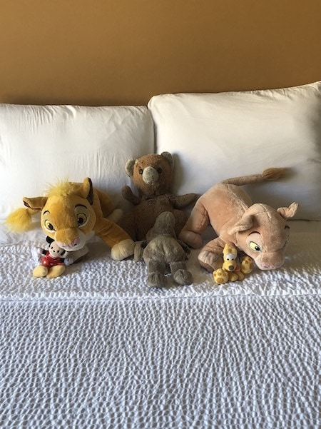 stuffed animals on a bed evacuating