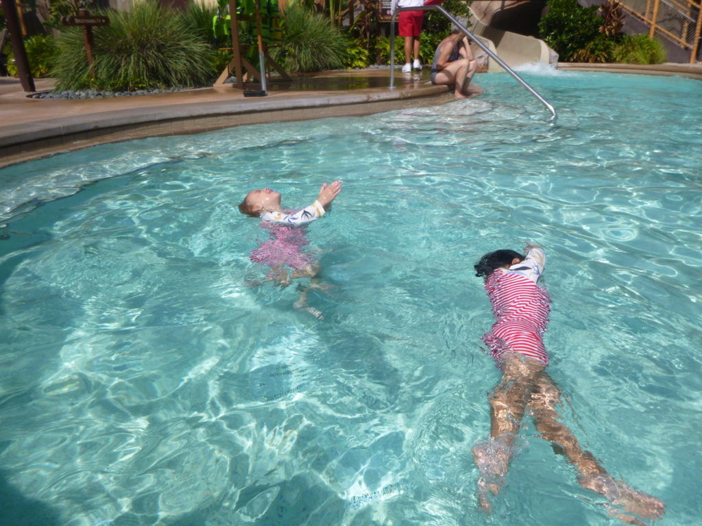 girls swimming in pool disney world with twins