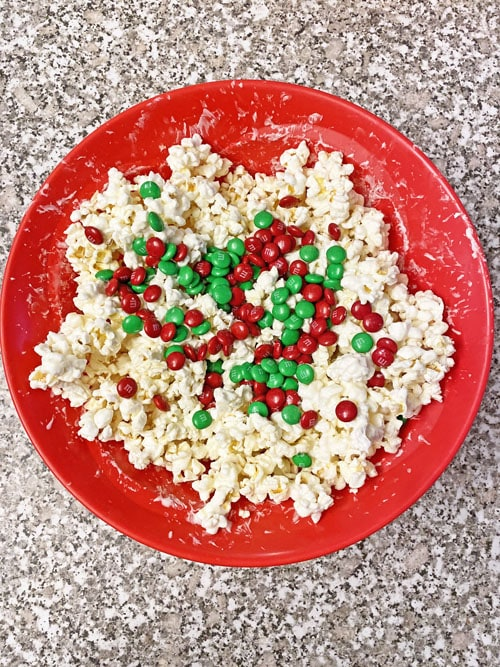 popcorn white chocolate and m&ms in red bowl