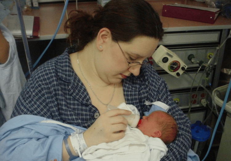 Nat bottle feeding baby in the Hospital