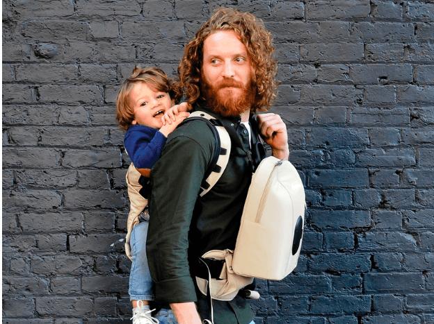 dad wearing toddler on his back babywearing