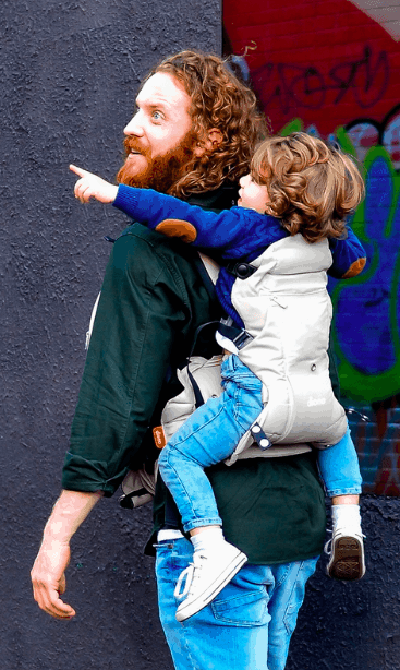 dad carrying toddler on his back babywearing