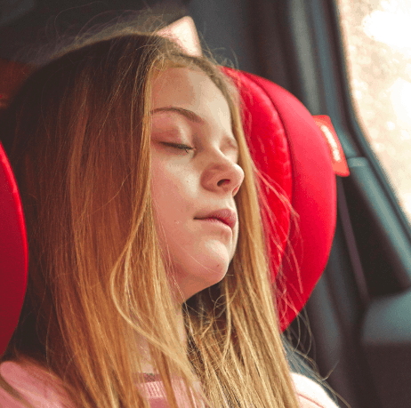 girl asleep in car booster seat