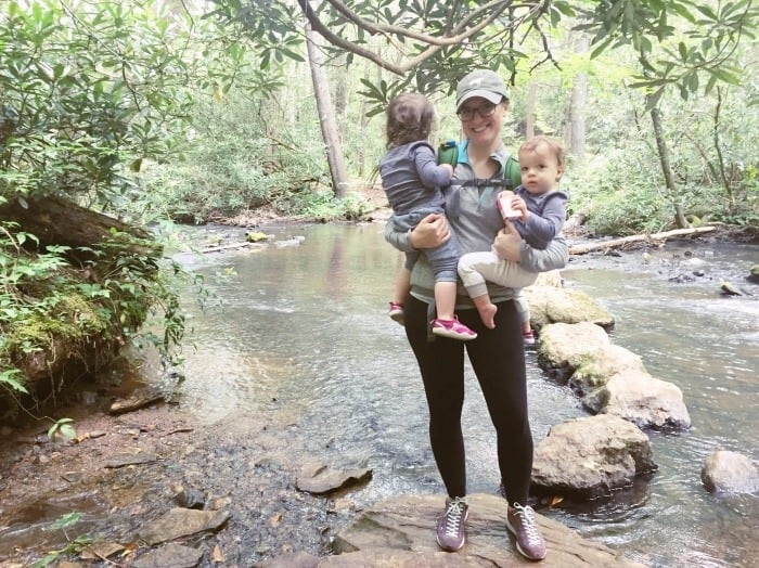 twin toddlers and mom standing by a creek