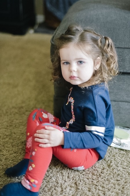 little girl sitting strong-willed child