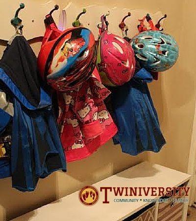 kids jackets hanging on hooks