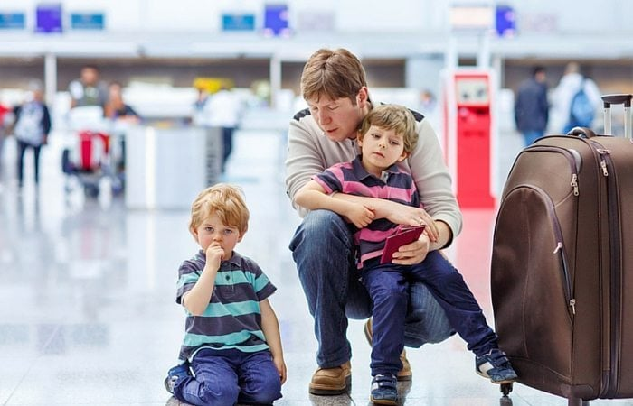 Dad and twin boys in airport