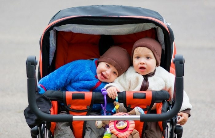twin toddlers in stroller