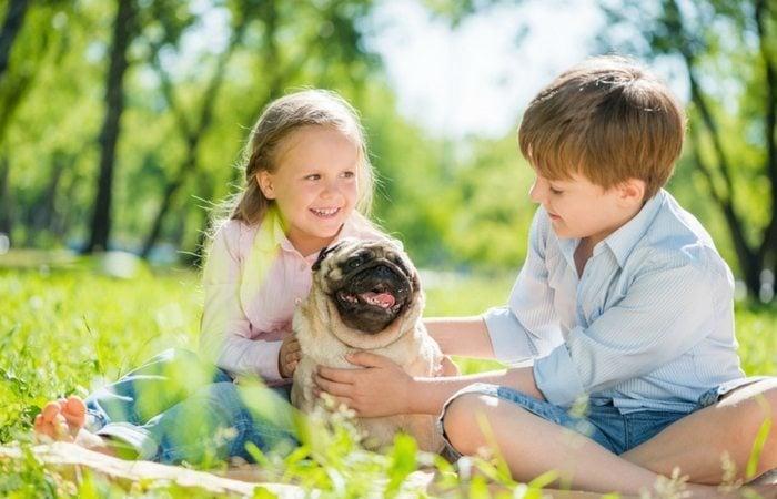 Boy and girl and dog
