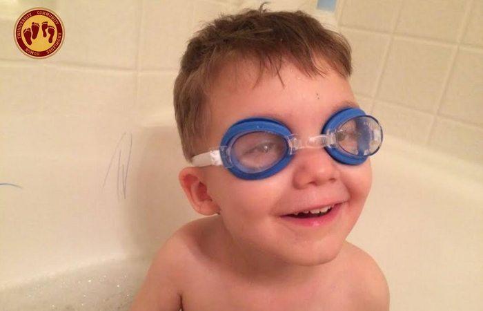 boy in bathtub with goggles on