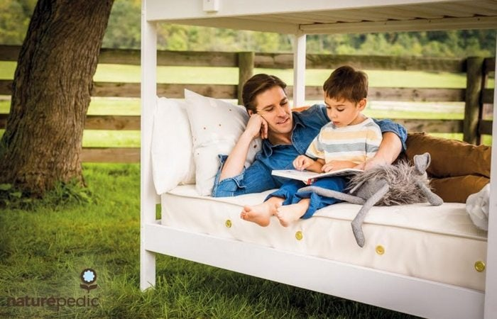 Naturepedic dad and son bunkbed reading