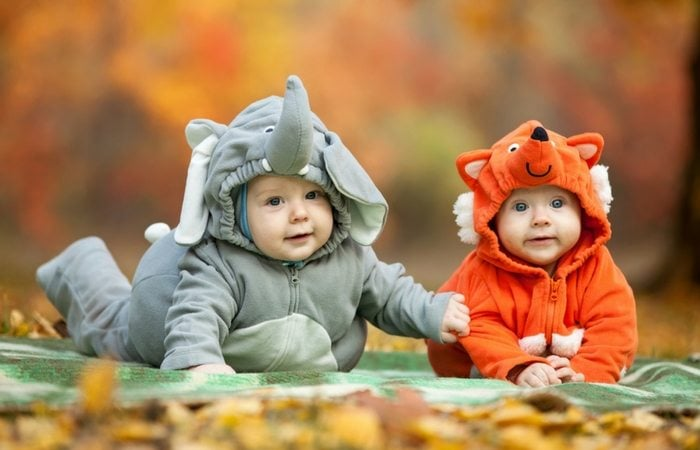 twins in halloween costumes
