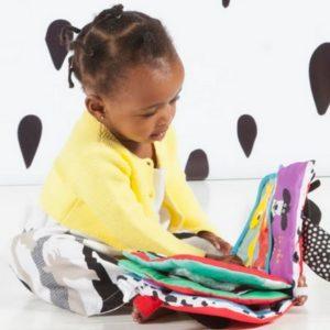 Manhattan toy girl reading baby book