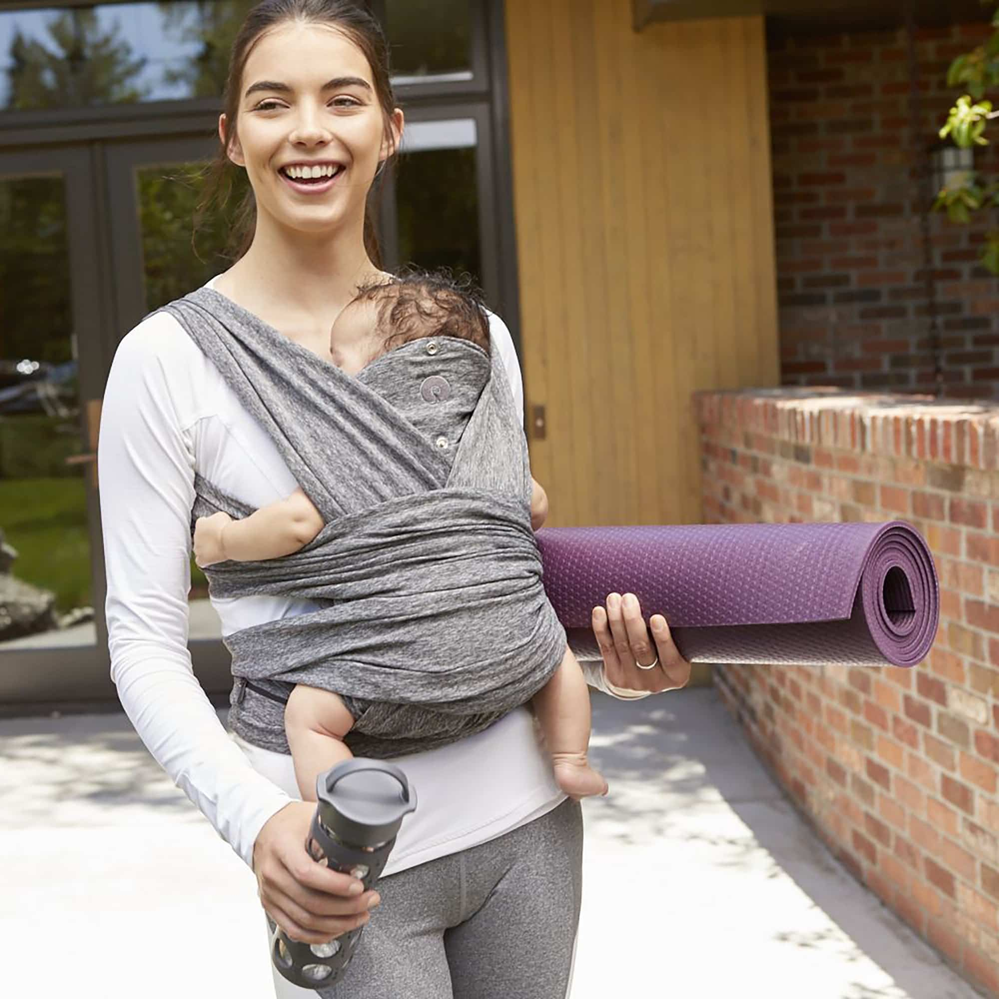 a5fb599770a mom with baby in carrier at yoga studio truth about babywearing