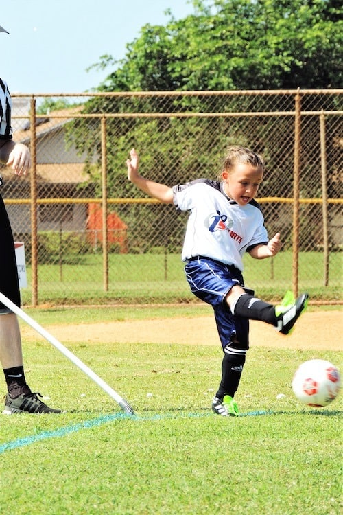 girl playing soccer after-school activities