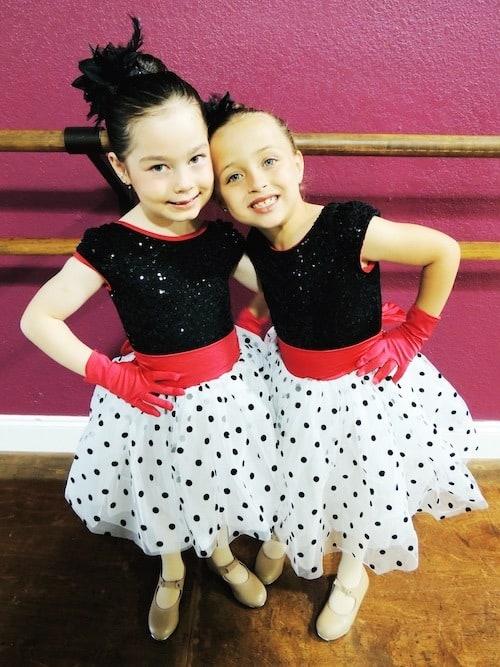 twin girls in dance class costumes after-school activities