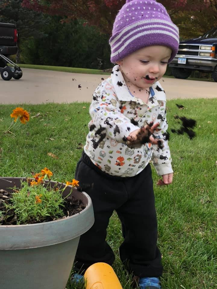 little boy throwing dirt outside why are you covered in poop