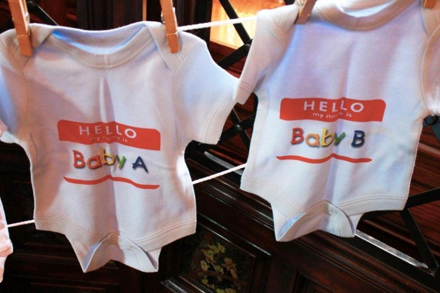 twin onesies on a clothesline twin baby shower etiquette