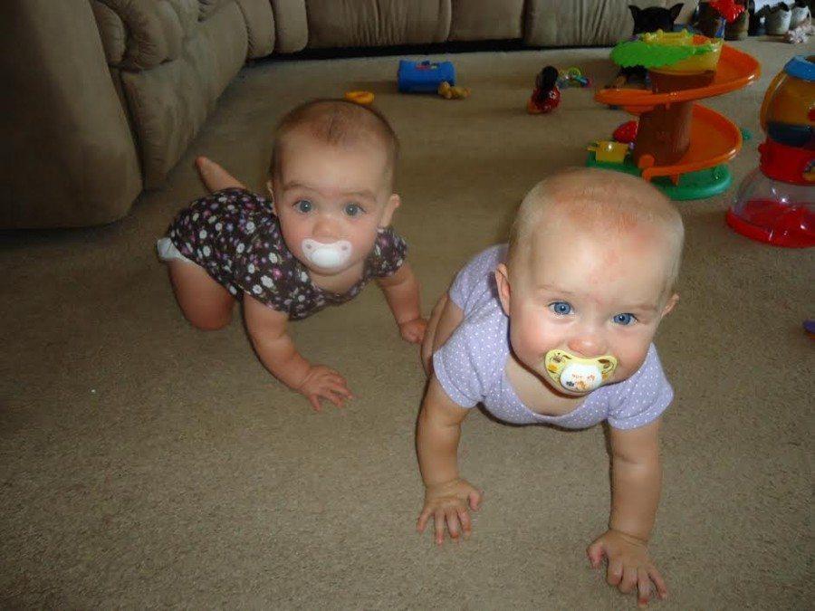twin babies crawling off pacifiers