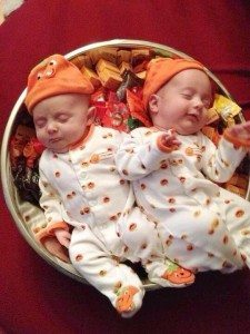 Two pumpkins in a candy bowl!