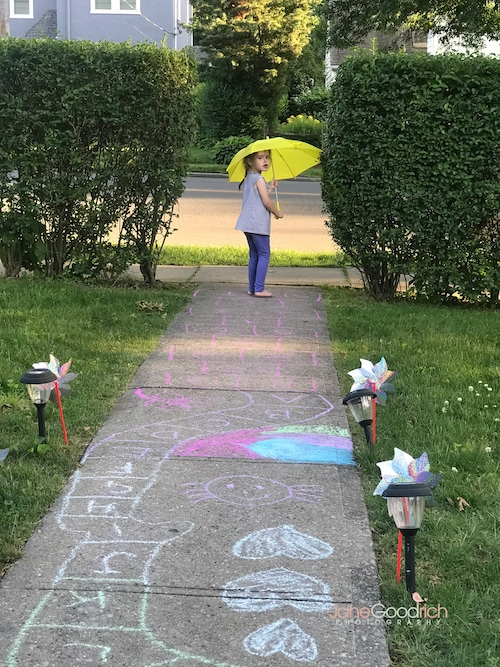 girl with umbrella by sidewalk chalk Special Moments You Need To Have Your Camera Ready For