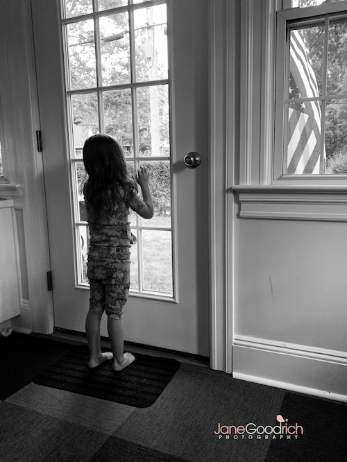 girl looking out the window of a door Special Moments You Need To Have Your Camera Ready For