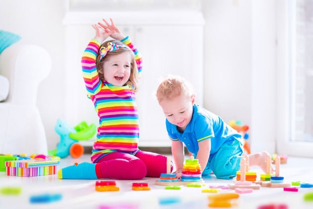 two kids playing on the floor creative play