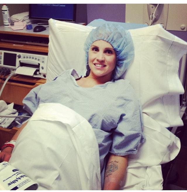 mom sitting in hospital bed before c-section prep tips