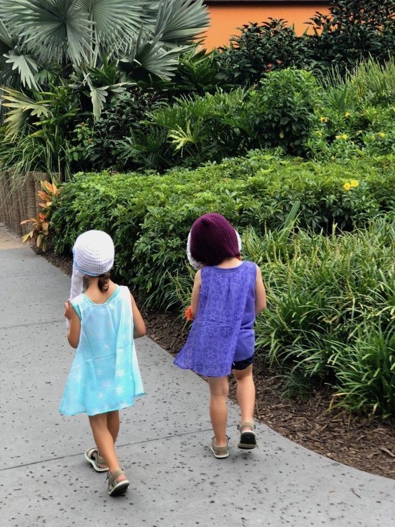 twin girls walking disney world with twins