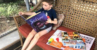 boy reading books diversify