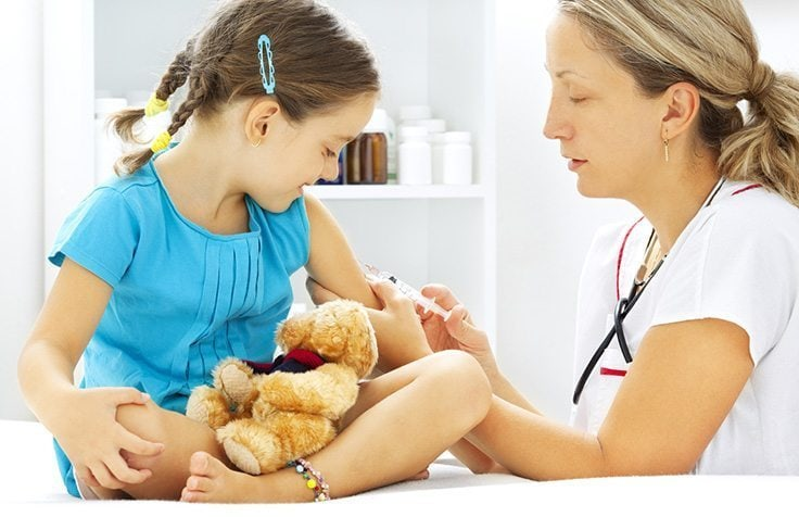 doctor giving injection to child doctor visits