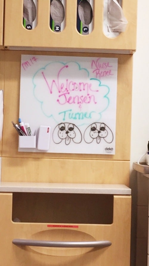 dry erase board in hospital room stating welcome jensen and turner ear tubes