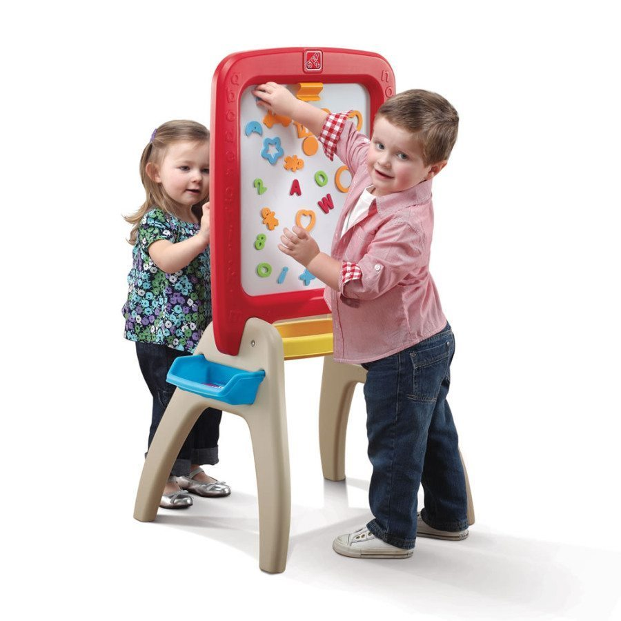two kids playing with an easel creative play