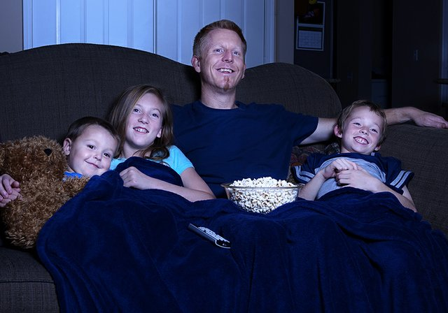 Image result for family watching movie