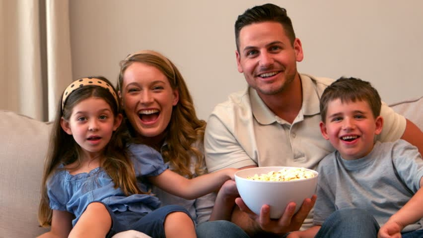 family watching tv with popcorn oscar-winning family-friendly movies