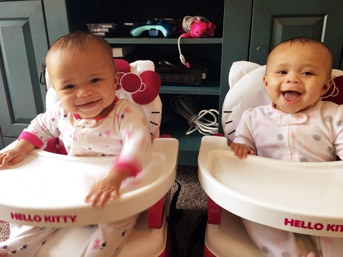 twins in high chairs family vacation
