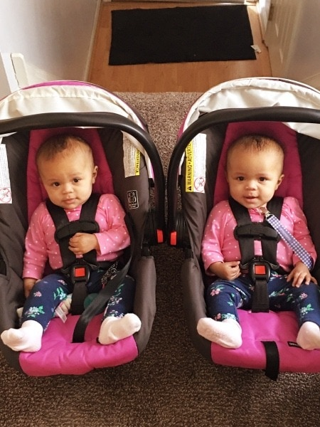 twins in car seats family vacation