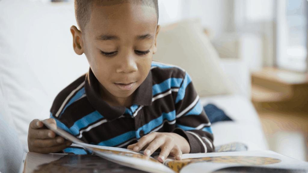 boy reading book kids reach their goals