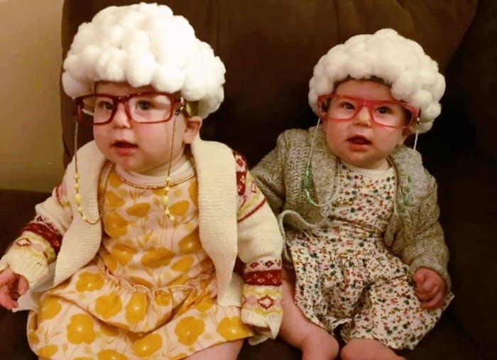 twin baby girls dressed up like old ladies