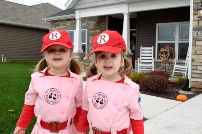 twin toddler girls dressed as rockford peaches baseball players from the movie A League of Their Own