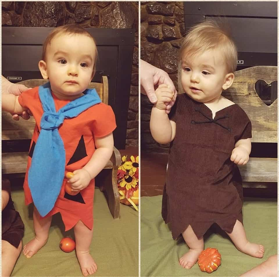 twin baby boys dressed as fred and barney from The Flintstones
