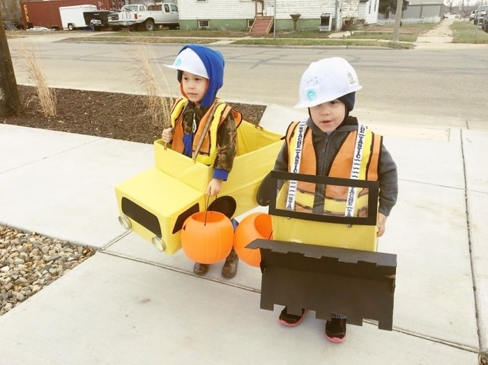 toddler twins dressed as construction vehicles