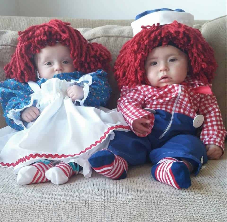 twin babies dressed up to look like raggedy ann and andy