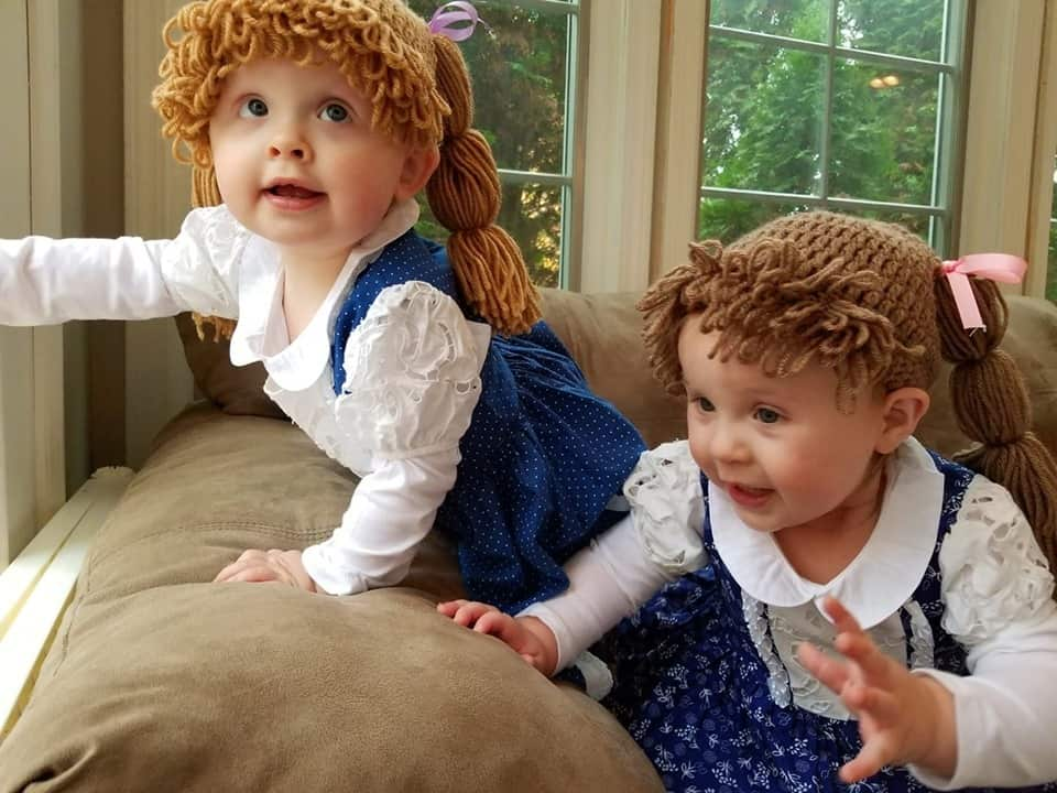 twin baby girls dressed up as cabbage patch kids