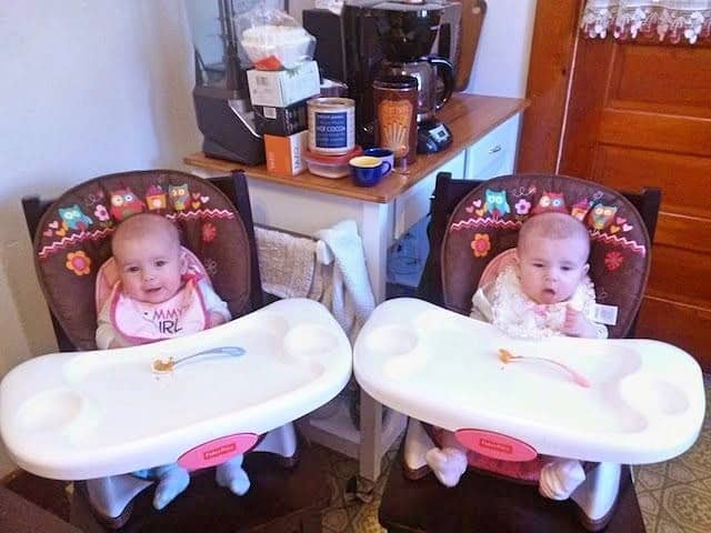 twins in high chairs running errands